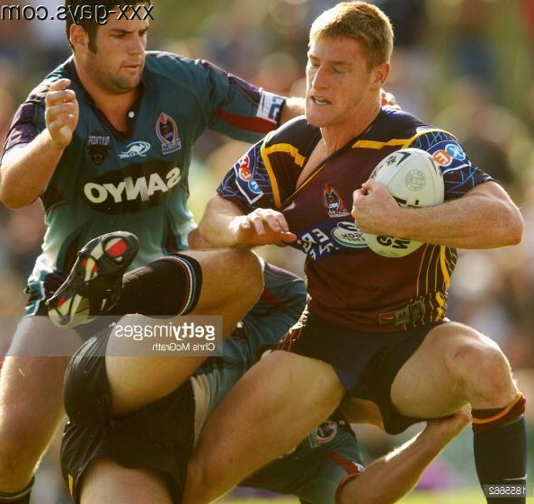 Brent Tate of the Brisbane Broncos is tackled by two Penrith Panthers players (Sydney, Mar. 16, 2003. Photographed by Chris McGrath) | Pants  Porn XXX | Hot XXX Gays